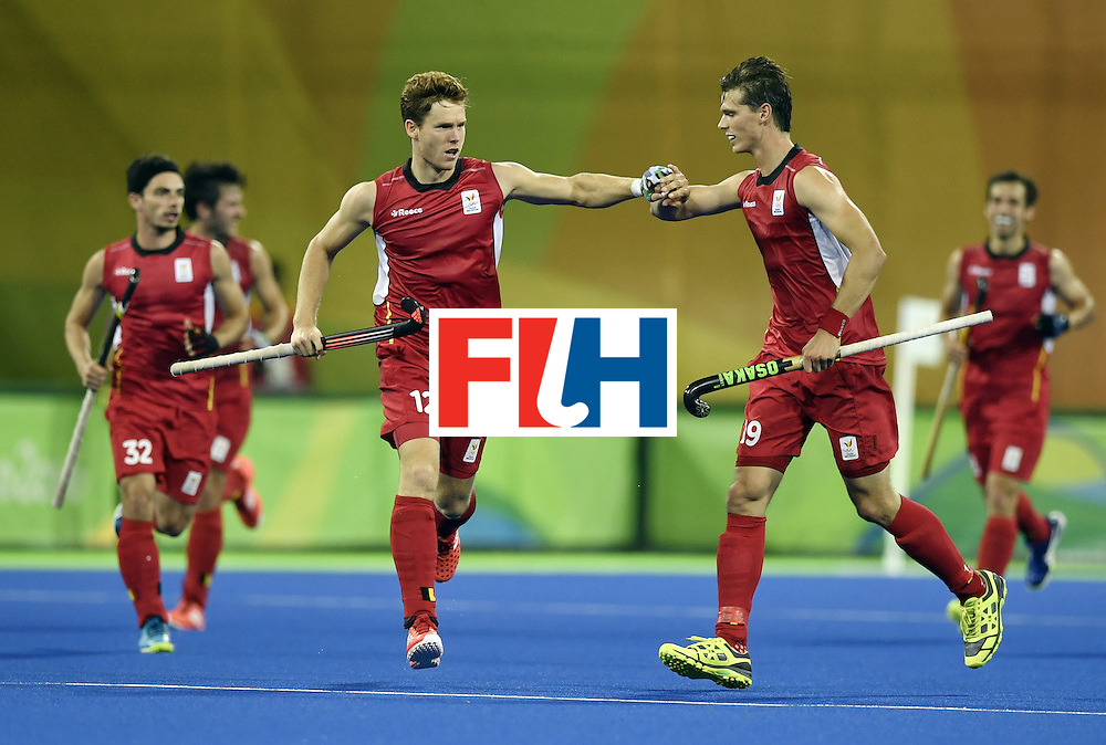 Belgium's Gauthier Boccard (3rd L) celebrates a goal during the men's Gold medal field hockey Belgium vs Argentina match of the Rio 2016 Olympics Games at the Olympic Hockey Centre in Rio de Janeiro on August 18, 2016. / AFP / PHILIPPE LOPEZ        (Photo credit should read PHILIPPE LOPEZ/AFP/Getty Images)