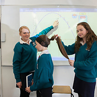 St John Bosco Community College Students Clare Finucan (Left) & Mary O'Connell (Right) pictured with their Model Leeann Turbidy who are competing in the BT Young Scientist & Technology competition with their X squared Curvature of Hair project.<br /> Pictured Credit  Brian Gavin Press 22