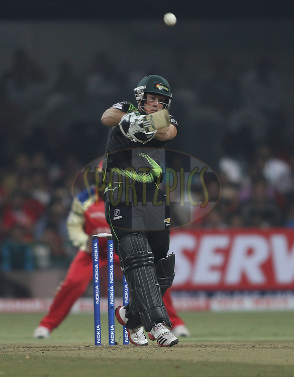 Colin Ingram of the Warriors top edges a delivery during match 1 of the NOKIA Champions League T20 ( CLT20 )between the Royal Challengers Bangalore and the Warriors held at the  M.Chinnaswamy Stadium in Bangalore , Karnataka, India on the 23rd September 2011..Photo by Shaun Roy/BCCI/SPORTZPICS