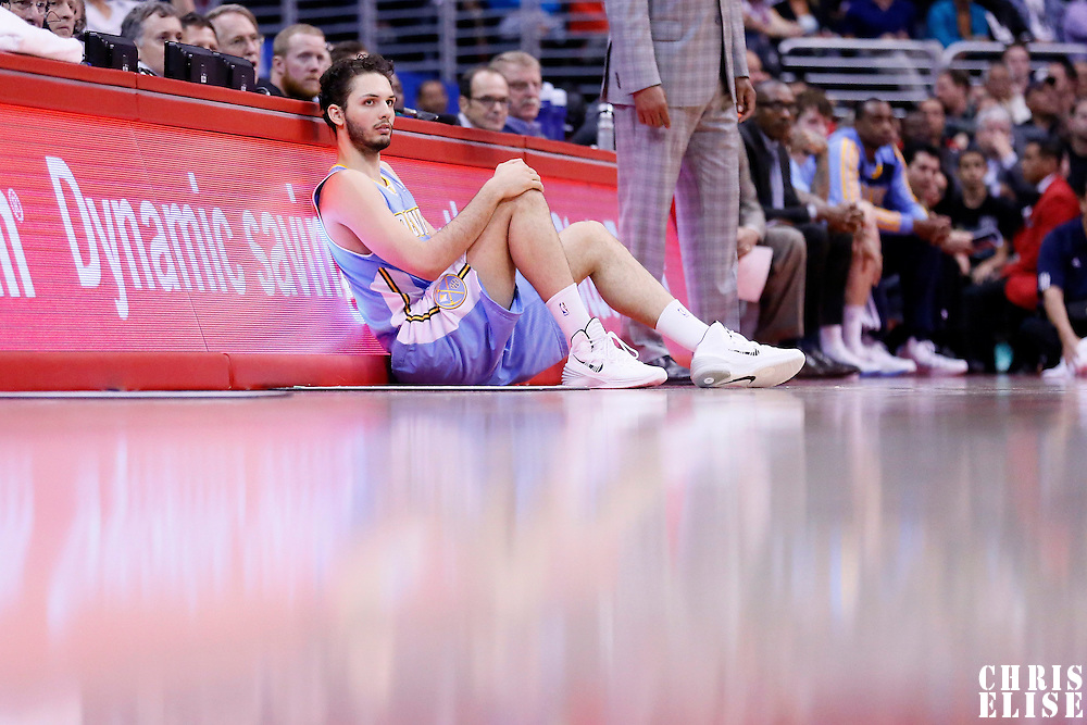 15 April 2014: Denver Nuggets guard Evan Fournier (94) waits to enter the game during the Los Angeles Clippers 117-105 victory over the Denver Nuggets at the Staples Center, Los Angeles, California, USA.