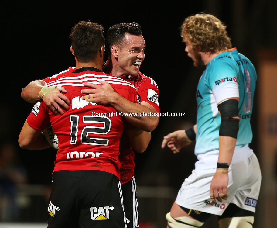 Dan Carter of the Crusaders runs in a try and is congratulated by Ryan Crotty during the Investec Super Rugby game between the Crusaders v Cheetahs at AMI Stadium in Christchurch. 21 March 2015 Photo: Joseph Johnson/www.photosport.co.nz