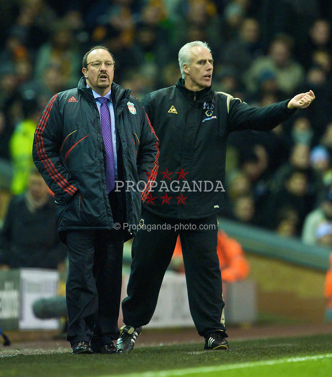 LIVERPOOL, ENGLAND - Saturday, December 26, 2009: Liverpool's manager Rafael Benitez and Wolverhampton Wanderers' manager Mick McCarthy during the Premiership match at Anfield. (Photo by: David Rawcliffe/Propaganda)