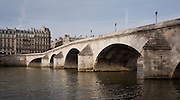 PARIS, FRANCE - APRIL 27 : A detail view of arches in the Pont Neuf, on April 27, 2008, in Paris, France. Opened in 1607 the Pont Neuf, or new bridge, is the oldest bridge in Paris. It was the first bridge without houses built on it, and the first to have pavements. It consists of two spans linking the Ile de la Cité to the two banks of the River Seine, with 7 arches in the span to the Right Bank, and 5 to the Left Bank. The arches and buttresses are reflected in the river on this spring morning. (Photo by Manuel Cohen)
