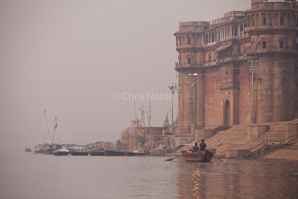 A pre-dawn view of the old city of Varnasi India from the Ganges River