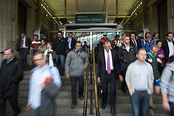 London Underground second day Tube strike affects Londoners. Commuters leave Waterloo station during the 48-hour tube strike in Central London, United Kingdom. Wednesday, 30th April 2014. Picture by Daniel Leal-Olivas / i-Images