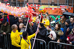© Licensed to London News Pictures . 26/01/2020. Manchester, UK. A dragon dances in front of crowds in St Peter's Square . Thousands of people watch a display of oriental culture and a procession through Manchester city centre to mark Chinese New Year . Photo credit: Joel Goodman/LNP