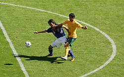 FIFA World Cup 2006 Tsuneyasu Miyamoto of Japan and Tim Cahill of Australia