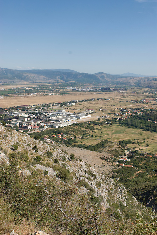 Overlook over city in bare landscape. Medjugorje. Bosnien. Eastern Europe.