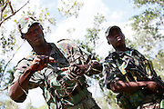 Nkwe wildlife security services offer a paramilitary - style rhino protection service that operates in the several private game reserves in the Limpopo area of South Africa..Nkwe's recruits undergo a basic two week training program focusing on military discipline and endurance to become a field ranger. From this stage the field rangers may be selected for an advance course that focuses on firearms and tactical training. Once this is completed they will be given rank and go on armed patrol to protect the rhinos...Pic shows: Corporal Habile Sithebe removes an animal snare planted by poachers...Nkwe Wildlife Security Services based in the Lapalala Wilderness Area, Limpopo, South Africa...© Zute Lightfoot