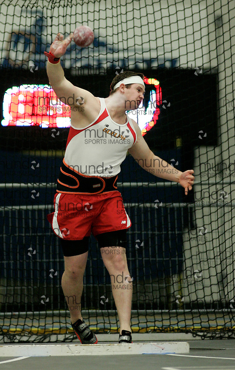 (Windsor, Ontario---13 March 2010) Tim Hendry of University of Guelph Gryphons   competes in the men's shot put at the 2010 Canadian Interuniversity Sport Track and Field Championships at the St. Denis Center. Photograph copyright Julie Robins/Mundo Sport Images. www.mundosportimages.com