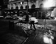 A man shoveling snow. An image from S. R. Shilling II's photographic series documenting his experience observing United State's largest city, New York.