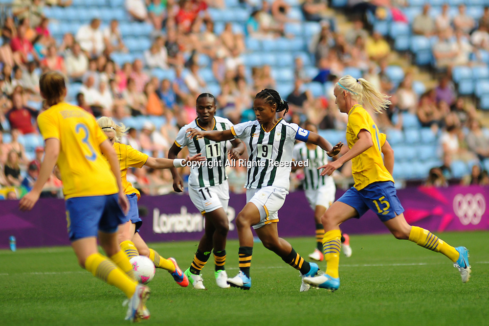 25.07.2012 Coventry, England. Amanda DLAMINI (South Africa) and Caroline SEGER (Sweden)  in action during the Olympic Football Women's Preliminary game between Sweden and South Africa from the City of Coventry Stadium