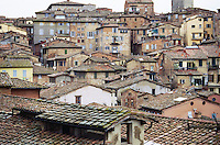 Old buildings of Siena crowded on hillside Italy
