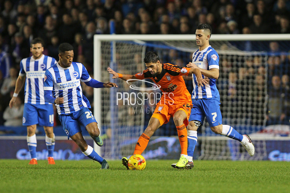 Ipswich Town midfielder Kevin Bru (17) holds off Brighton central midfielder, Beram Kayal (7) during the Sky Bet Championship match between Brighton and Hove Albion and Ipswich Town at the American Express Community Stadium, Brighton and Hove, England on 29 December 2015. Photo by Geoff Penn.