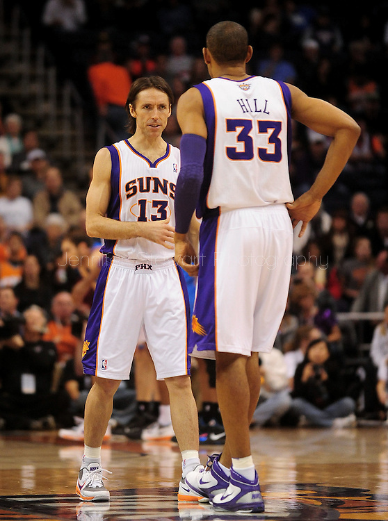 Feb. 4, 2011; Phoenix, AZ, USA; Phoenix Suns guard Steve Nash (13) reacts on the court with teammate forward Grant Hill (33) while playing against the Oklahoma City Thunder at the US Airways Center. The Thunder defeated the Suns 111-107. Mandatory Credit: Jennifer Stewart-US PRESSWIRE.