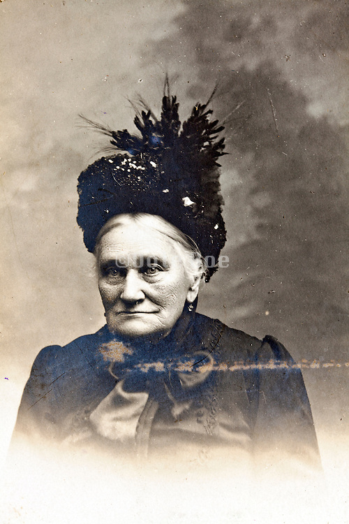 damaged 1900s portrait of elderly woman