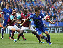 Michail Antonio of West Ham United and Shinji Okazaki of Leicester City (R) in action - Mandatory by-line: Jack Phillips/JMP - 17/04/2016 - FOOTBALL - King Power Stadium - Leicester, England - Leicester City v West Ham United - Barclays Premier League