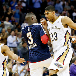 Nov 22, 2013; New Orleans, LA, USA; New Orleans Pelicans power forward Anthony Davis (23) celebrates with shooting guard Anthony Morrow (3) during the second half of a game at New Orleans Arena. The Pelicans defeated the Cavaliers 104-100. Mandatory Credit: Derick E. Hingle-USA TODAY Sports
