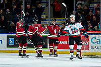 KELOWNA, BC - FEBRUARY 15: Tyson Feist #25 of the Kelowna Rockets watches the replay as Kyle Masters #2, Chris Douglas #12 and Cameron Hausinger #10 of the Red Deer Rebels celebrate a goal at Prospera Place on February 15, 2020 in Kelowna, Canada. (Photo by Marissa Baecker/Shoot the Breeze)