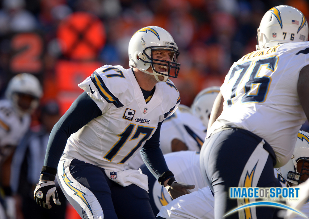 Jan 12, 2014; Denver, CO, USA; San Diego Chargers quarterback Philip Rivers (17) reacts during the 2013 AFC divisional playoff football game against the Denver Broncos at Sports Authority Field at Mile High.