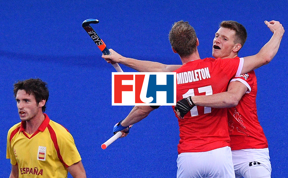 Great Britain's Sam Ward (R) and Britain's Barry Middleton celebrate in front of Spain's Vicenc Ruiz (L) after the mens's field hockey Britain vs Spain match of the Rio 2016 Olympics Games at the Olympic Hockey Centre in Rio de Janeiro on August, 12 2016. / AFP / Carl DE SOUZA        (Photo credit should read CARL DE SOUZA/AFP/Getty Images)