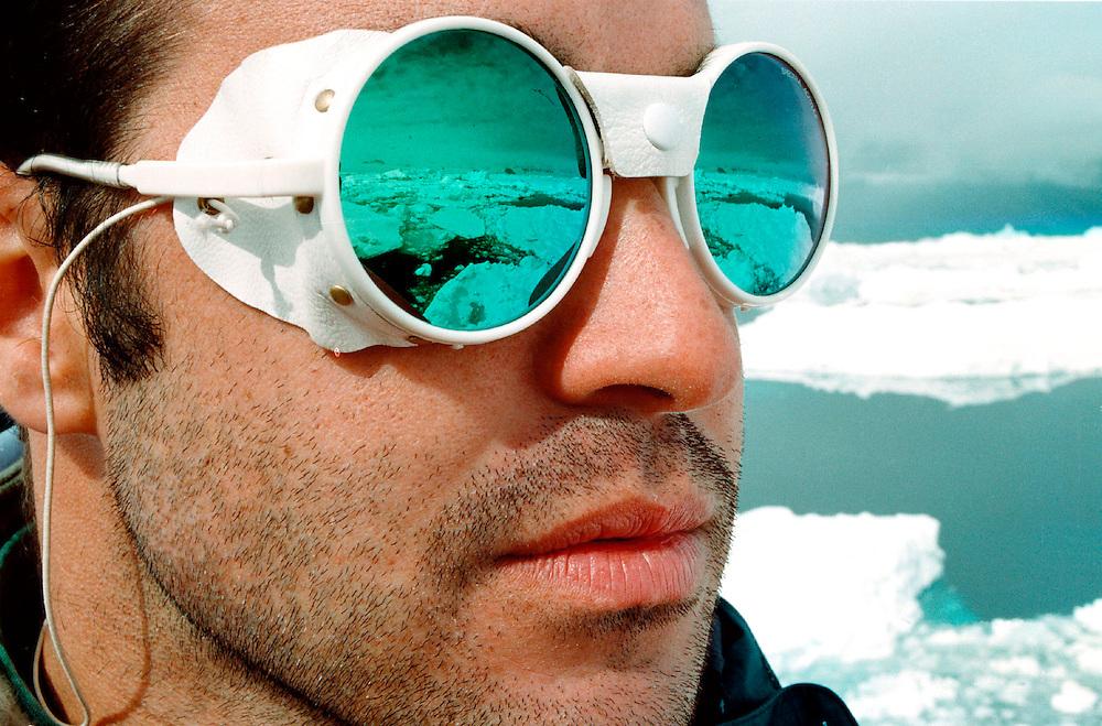 Greenpeace campaigner Emilio Escurra aboard ARCTIC SUNRISE landscape reflecting in his sunglasses Accession #: 2.97.081.006.08