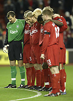 Photo Aidan Ellis.<br /> Liverpool v Middlesbrough<br /> Carling Cup 4th rd.<br /> 10/11/2004.<br /> Liverpool's  team obey a minute silence for the late Emelyn Hughes