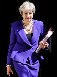 July 4, 2018 - London, United Kingdom - Prime Minister THERESA MAY leaving 10 Downing Street this morning for Prime Minister's Questions. (Credit Image: © Gustavo Valiente/i-Images via ZUMA Press)