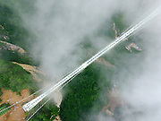 ZHANGJIAJIE, CHINA - JUNE 25:<br /> <br /> Aerial view of the glass-bottomed bridge receiving a safety test at Zhangjiajie Grand Canyon on June 25, 2016 in Zhangjiajie, Hunan Province of China. World\'s tallest and longest glass-bottomed bridge has been completed and took a global broadcast through television and internet medias to show its safety. More than thirty citizens and visitors thumped the bridge with hammer in the test event.<br /> ©Exclusivepix Media