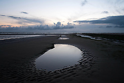© Licensed to London News Pictures. 26/03/2014<br /> <br /> Redcar, Cleveland, United Kingdom<br /> <br /> Morning light is reflected in a pool of seawater on the beach at Redcar in Cleveland.<br /> <br /> Photo credit : Ian Forsyth/LNP