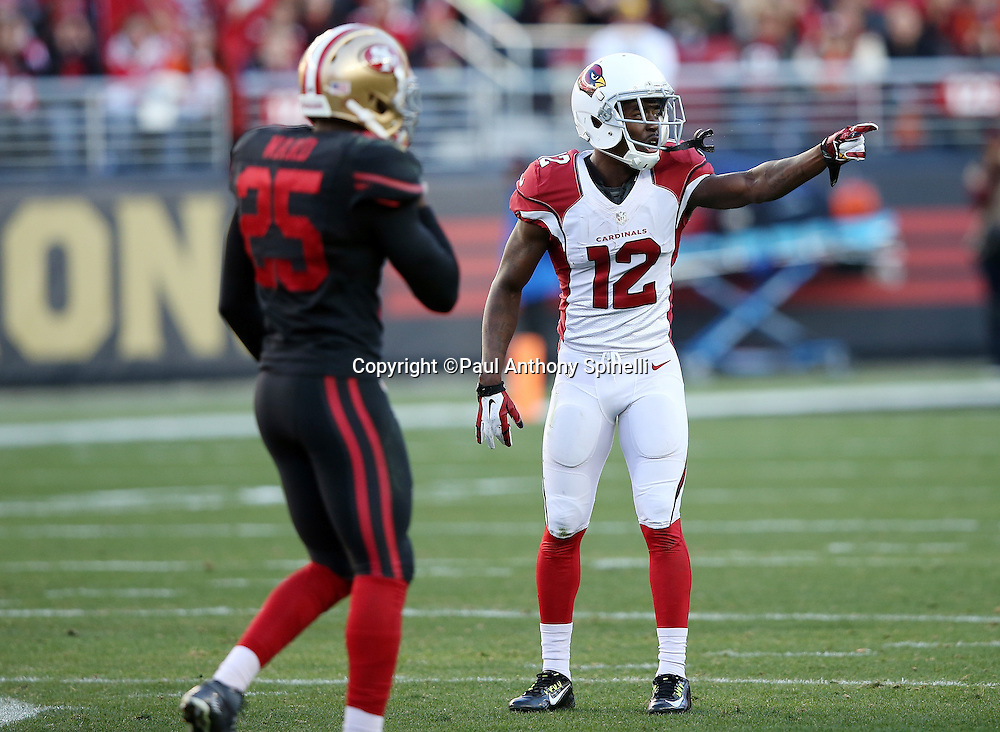 Arizona Cardinals wide receiver John Brown (12) points as he gets set to go out for a pass while covered by San Francisco 49ers strong safety Jimmie Ward (25) during the 2015 week 12 regular season NFL football game against the San Francisco 49ers on Sunday, Nov. 29, 2015 in Santa Clara, Calif. The Cardinals won the game 19-13. (©Paul Anthony Spinelli)