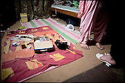 "Dressing room in a common ..apartment shared by five transvestites,  friends belong to the middle class. Late afternoon in south Rawalpindi, Pakistan on Friday, November 28 2008.....""Not men nor women"". Just Hijira, Kusra. Painted lips, Kajal surrounding ..their eyes and colourful veils..Pakistan is today considered a strongly, foundamentalist as well, ..islamic country. But under its reputation, above all over the talebans' ..continuos advancing, stirs a completely extraneous world, a multiethnic ..mixed society. Transvestites make part of it, despite this would not be ..admitted by a strict law..Third gender, the Hijira are born as men (often ermaphrodites) or with ..an ambiguous genital situation, and they have their testicles and penis ..removed through a - often brutal - surgical operation. The peculiarity ..is that this operation does not contemplate the reconstruction of a ..female organ. This is the reason why they are not considered as men nor ..women, just Hijira. They are often discriminated, persecuted  and taxed ..with being men prostitutes in the muslim areas. The members of this ..chast perform dances during celebrations, especially during weddings, ..since it is anciently believed that an EUNUCO's dance and kiss in the ..wedding day brings good luck to the couple's fertility...To protect the identities of the recorded subjects names and specific ..places are fictionals."