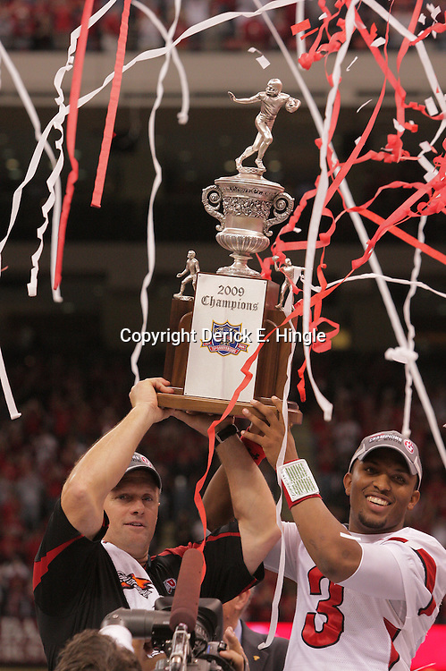 2 January 2009: Utah head coach Kyle Whittingham and quarterback Brian Johnson hold up the Allstate Sugar Bowl championship trophy following a 31-17 win by the Utah Utes over the Alabama Crimson Tide in the 75th annual Allstate Sugar Bowl at the Louisiana Superdome in New Orleans, LA.