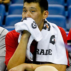October 24, 2012; New Orleans, LA, USA; Houston Rockets point guard Jeremy Lin (7) ices his knee on the bench during the fourth quarter of a preseason game at the New Orleans Arena. Lin returned to the game late in the fourth quarter as the Rockets defeated the Hornets 97-90. Mandatory Credit: Derick E. Hingle-US PRESSWIRE