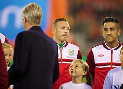 BRUSSELS, BELGIUM - Tuesday, October 15, 2013: The King of Belgium Philip meets Wales' Craig Bellamy before the 2014 FIFA World Cup Brazil Qualifying Group A match at the Koning Boudewijnstadion. (Pic by David Rawcliffe/Propaganda)
