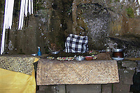 Bali, Gianyar, Goa Gajah. The elephant cave. A Buddha figure outside the cave, the other was stolen in 2000.