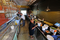 JOHANNESBURG SOUTH AFRICA - MAY 01 Delta Cafe and DQ staff prepare for delivery on May 01, 2020 in Johannesburg South Africa. South Africa moved down to Level 4 of the national lockdown with relaxed restrictions as part of a risk adjusted 5 stage phasing of lockdown measures. This includes allowing of certain restaurants to reopen for trade and prepare hot food as delivered takeaway only. (Photo by Gallo Images/ Dino Lloyd)