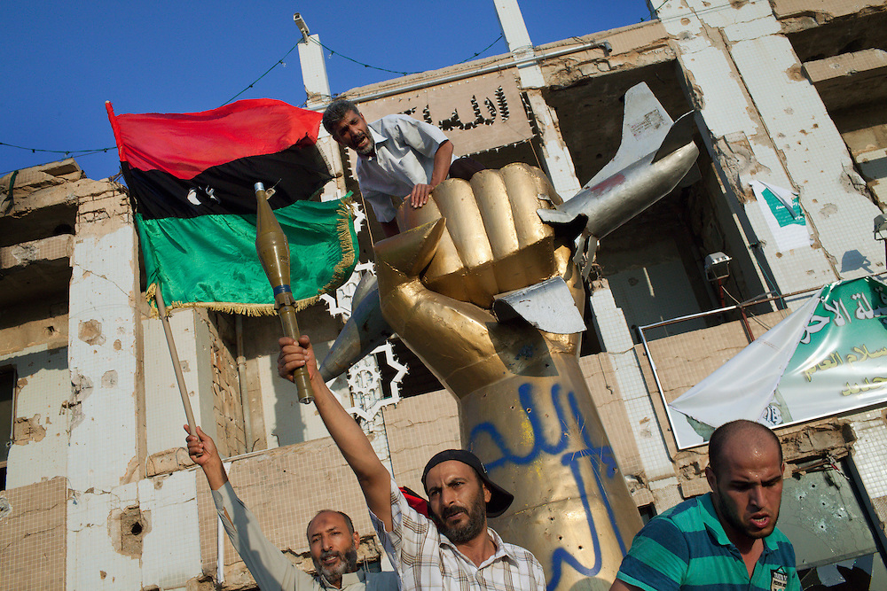Rebels on the monument that remeber the  the Us forces shelling in 1986 in Bab Al Aziziain  the Qaddafi stronghold.