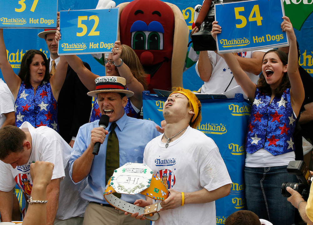 NEW YORK, NY-06 JUL04-- Victor Takeru Kobayashi holds the mustard yellow belt shortly after eating 53 and 3/4 hot dogs in 12 minutes. (Extra) The Gazette/Liam Maloney