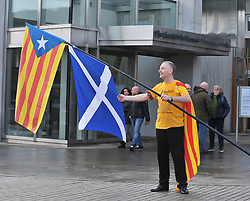 Pictured: Jordie McArthur from Glasgow get's his Catalan and Scottish flags ready for the rally.<br /> <br /> Supporters of Catalonian independence held a rally outside the Scottish Parliament on the day of the controversial elections in the parliament in the Spanish region.<br /> <br /> © Dave Johnston/ EEm
