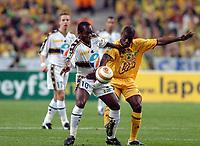 Fotball<br /> Fransk ligacupfinale<br /> Nantes v Sochaux<br /> 17. april 2004<br /> Foto: Digitalsport<br /> NORWAY ONLY<br /> <br /> WILSON ORUMA (SOC) / EMERSE FAE (NAN)