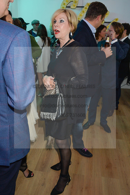 TINA MOORE at a private view of an exhibition entitled 'All Shook Up' - by Natasha Archdale: A Retrospective held at 90 Piccadilly, London on 23rd April 2015.