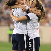 Lauren Cheney, USA, (left), celebrates with team mates Megan Rapinoe, (centre) and Kelley O'Hara, after scoring her sides fifth goal during the U.S. Women Vs Korea Republic friendly soccer match at Red Bull Arena, Harrison, New Jersey. USA. 20th June 2013. Photo Tim Clayton