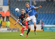 Portsmouth defender Christian Burgess beats Carlisle United Forward Hallam Hope to the ball during the Sky Bet League 2 match between Portsmouth and Carlisle United at Fratton Park, Portsmouth, England on 2 April 2016. Photo by Adam Rivers.