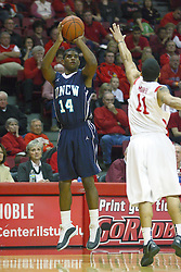 03 December 2011:  Nic Moore can' reach a shot by K. K.  Simmons in time during an NCAA mens basketball game where the University of North Carolina at Wilmington Seahawks defeated the Illinois State Redbirds 63-54 inside Redbird Arena, Normal IL