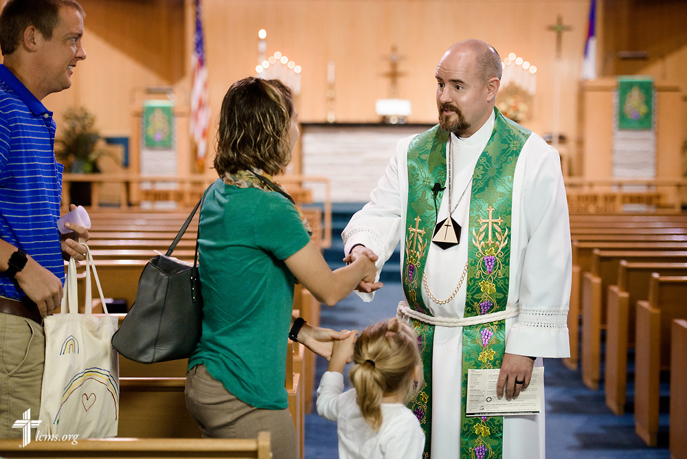 The Rev. Dr. Heath Trampe greets parishioners following worship on Sunday, Sept. 24, 2017, at Faith Lutheran Church, York, Neb. LCMS Communications/Erik M. Lunsford