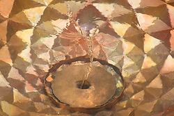 Copper bowl water feature emulating the mathematically perfect Fibonacci spiral in the Winton Beauty of Mathematics Garden, RHS Chelsea Flower Show 2016