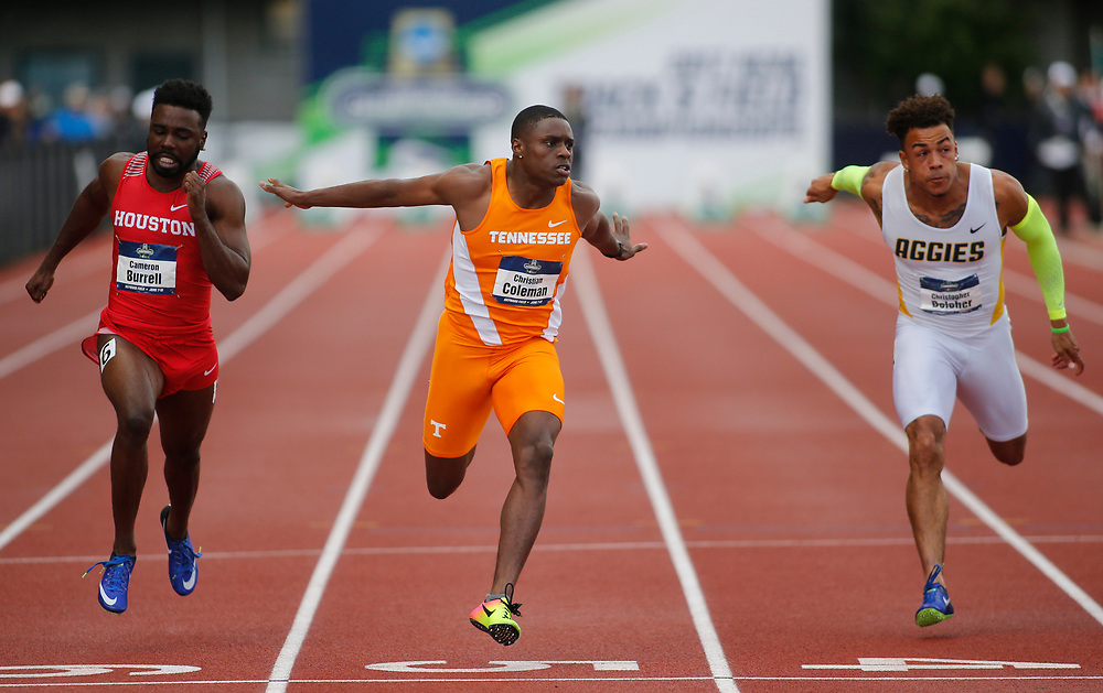 Tennessee's Christian Coleman, center, beats Houston's Cameron Burrell, left, and North Carolina A&T's Christopher Belceher, right, to win the men's 100 meters on the third day of the NCAA outdoor college track and field championships in Eugene, Ore., Friday, June 9, 2017. Coleman's won in 10.04 seconds, Burrell finished second and Belcher third. (AP Photo/Timothy J. Gonzalez)