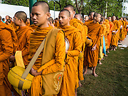 01 JANUARY 2016 - BANGKOK, THAILAND:  Buddhist monks participate in the annual New Year's mass merit making ceremony on at Sanam Luang in Bangkok. The ceremony is sponsored by the Bangkok city government. More than 500 Buddhist monks participated in the ceremony this year. Thais usually go to temples and religious observances to meditate and make merit on New Year's Day.           PHOTO BY JACK KURTZ