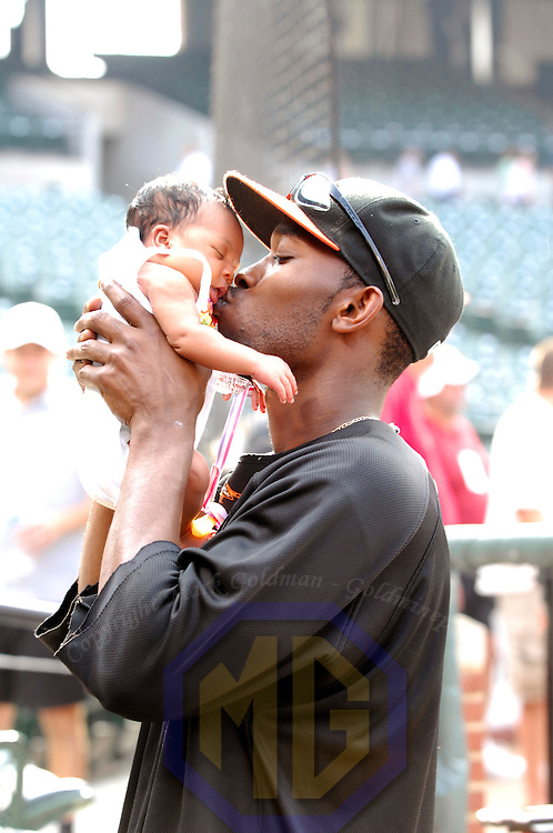 28 July 2007:  Baltimore Orioles shortstop Freddie Bynum (3) kisses his two week old baby daughter prior to the game against the New York Yankees.  The Orioles defeated the Yankees 7-5 at Camden Yards in Baltimore, MD.   ****For Editorial Use Only****